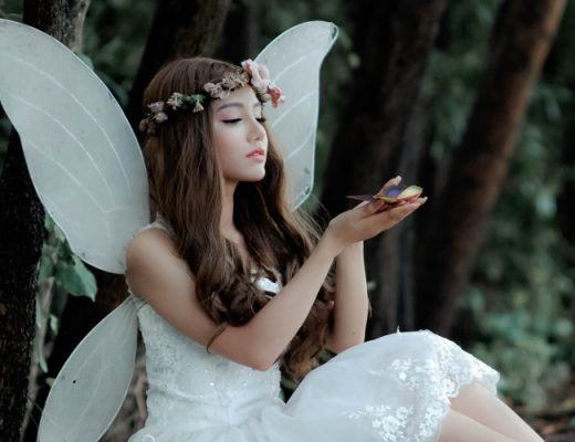 A sweet fairy watching a butterfly