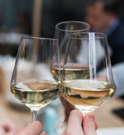 Raising wine glasses in celebration
