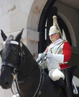 man with helmet on horseback